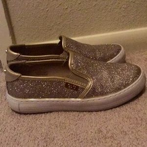 G by Guess slip on shoes. Gold with a white sole.